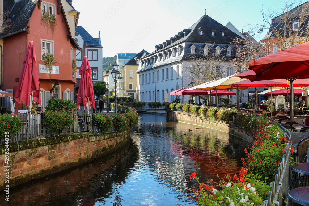 Fototapety, obrazy: 18 Oct 2019, Saarburg, West Germany - historical city center. Area near the river with restaurants.