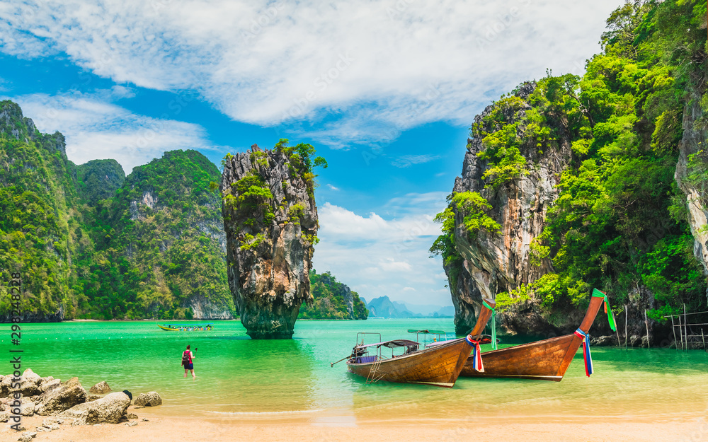 Fototapeta Amazed nature scenic landscape James bond island with boat for traveler Phang-Nga bay, Attraction famous landmark tourist travel Phuket Thailand summer vacation trips, Tourism destinations place Asia