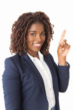 Happy Young Professional Having New Idea, Pointing Index Finger Up. African American Business Woman Standing Isolated Over White Background, Looking At Camera, Smiling. New Idea Concept