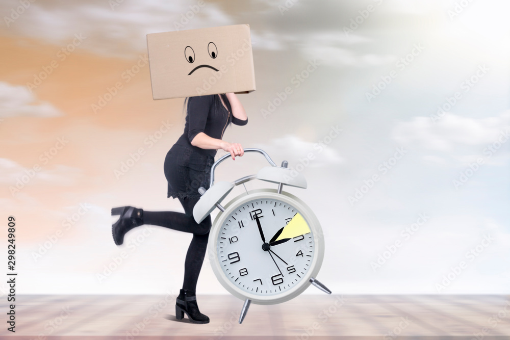 Fototapety, obrazy: Woman with big clock in hand is running against time change