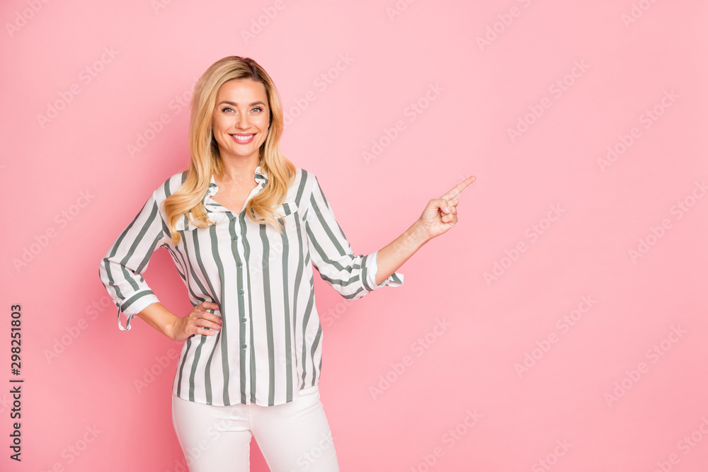 Fototapety, obrazy: Photo of cheerful white cute nice attractive woman pointing at empty space to be filled with advertisiment smiling toothily isolated over pastel color background in trousers pants