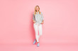 Full length body size photo of cheerful positive cute attractive nice woman holding hands in pockets standing confidently smiling toothily isolated over pink pastel color background