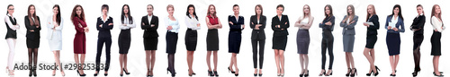 Fotografiet group of successful young businesswoman standing in a row