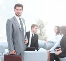 Confident Businessman With Bri...