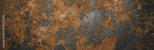 Grunge rusty dark metal background texture or backdrop, banner size