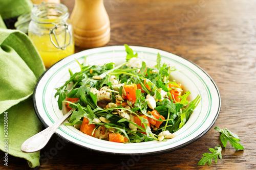 Photo salad with pumpkin, feta and arugula. . Selective focus