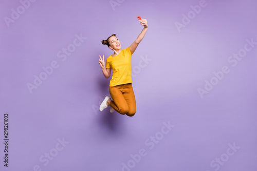 Full length photo of crazy lady jumping high holding telephone taking selfies sh Canvas Print