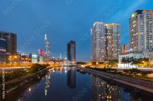 Fototapeta Saigon Cityscape at Sunrise. Skyline with cloudy sky, Modern City Skyline Riverside. ho chi minh , Vietnam. obraz na płótnie