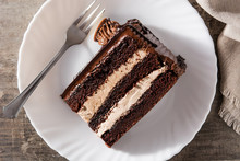 Chocolate Cake Slice On Wooden Table. Top View