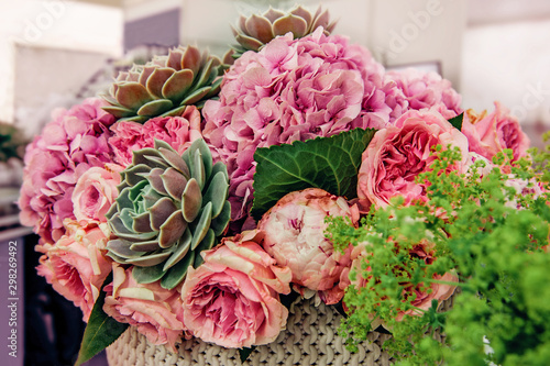Foto auf Leinwand Blumen Beautiful bouquet of pink peony roses with exotic succulents roses. Trends in modern floristry. Selective focus
