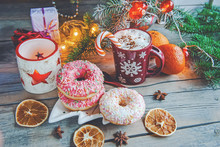 Pink Donuts Lie On The Christmas Table Next To Eggnog And Tangerines. New Year Celebration