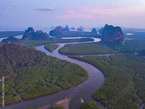 Montage in der Fensternische Aubergine lila Aerial top view of Samet Nangshe, mountain valley hills, and tropical green forest trees at sunset with Andaman sea in Phang Nga Bay in summer, Thailand in travel trip. Natural landscape background.