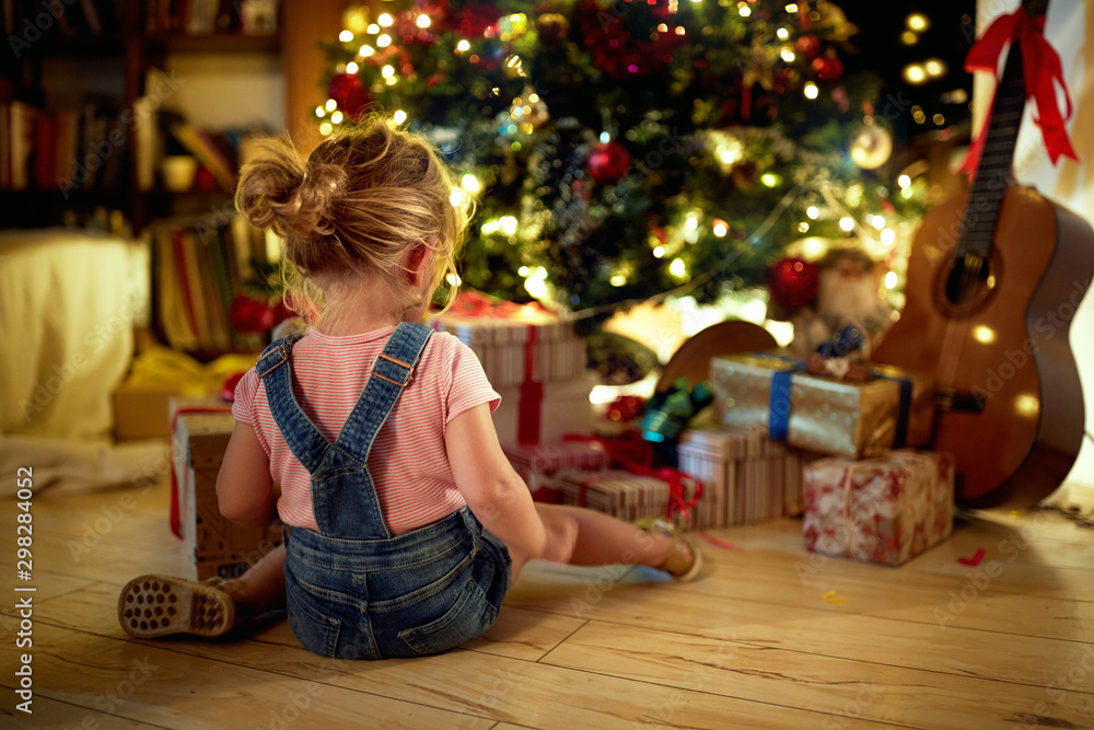 Fototapety, obrazy: Happy girl open Christmas presents. Christmas magic in home.
