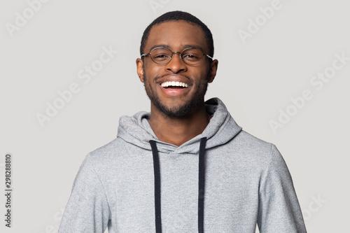 Fotografie, Obraz  Head shot portrait laughing African American man in glasses