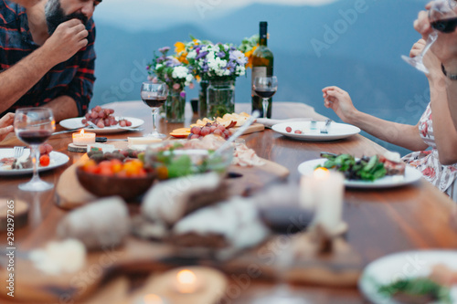 Slika na platnu Friends and family gathered for picnic dinner for Thanksgiving