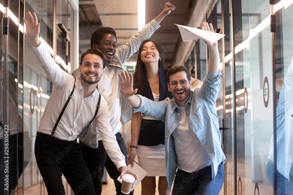 Fototapety, obrazy: Portrait happy diverse employees celebrating business victory in hallway