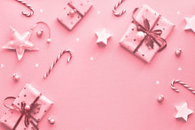 Festive Monochrome Pink Christmas Background With Pink Gift Boxes, Stripy Candy Canes, Trinkets And Decorative Stars, Geometric Flat Lay With Copy-space