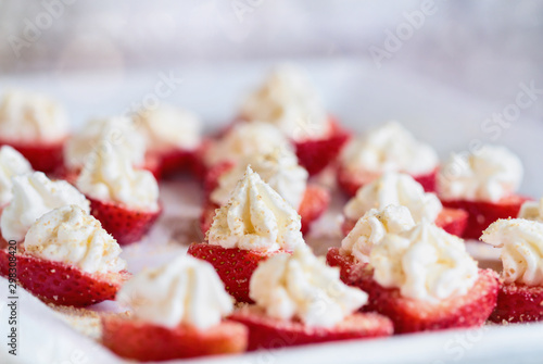 Stuffed strawberries filled with cheesecake filling made with whipped cream and cream cheese Canvas Print