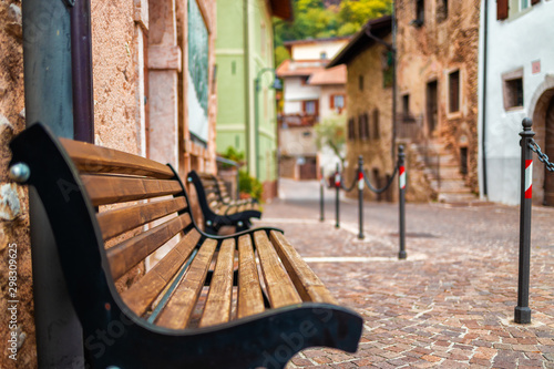 Old small stone street in Italy. City of Ranzo province of Trento. The foreground in focus, the background is blurred