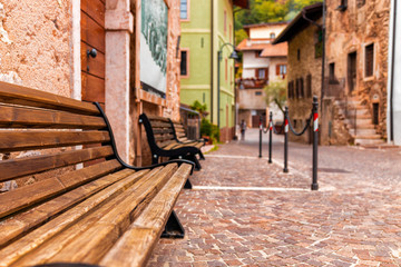 Fototapeta na wymiar Old small stone street in Italy. City of Ranzo province of Trento. The foreground in focus, the background is blurred