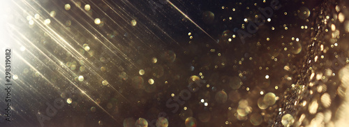 background of abstract glitter lights. gold and black. de focused. banner - 298319082