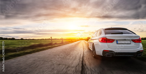 Photo Stands Cappuccino rental car in spain landscape road at sunset - copy space for text