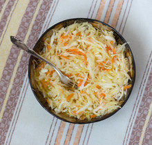 Sauerkraut In A Bowl On A Table On A Linen Napkin, Top View