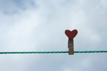 Heart  On Wooden Pegs On A Whi...