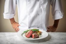 Chef Serving A Plate Of Tenderloin Steak