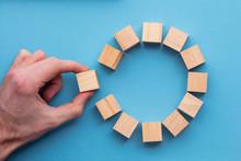 Hand Choosing A Wooden Block F...