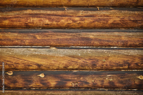 Photographie Wooden surface, large logs, log house