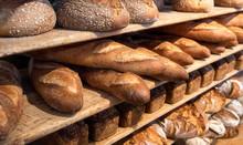 Bread Variety On Wooden Shelves. Bakery Goods. Freshly Baked