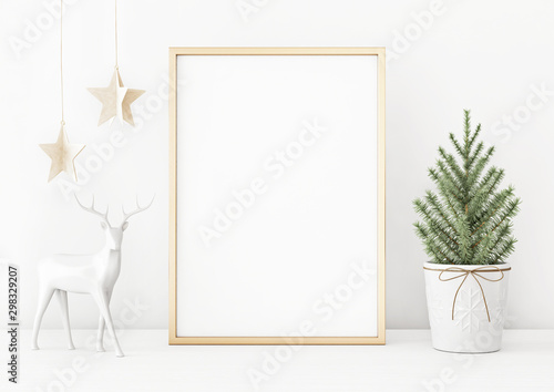 Fototapeta Vertical christmas poster mockup with golden frame, fir tree, star garland and deer on white wall background. 3D rendering, illustration. obraz