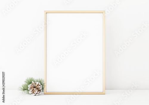 Poster Pierre, Sable Vertical christmas poster mockup with golden frame and pine cone on white wall background. 3D rendering, illustration.