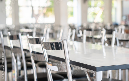 Fotografie, Tablou Stainless steel tables and chairs in high school student canteen, public cafeter