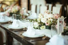 Floral Centerpiece On Dining T...