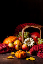 Autumn, Harvest Time. Composition With Ripe Organic Pumpkins, Apples, Red Scarf And Yellow Leaves. Basket On Background. Low Key, Dark And Moody