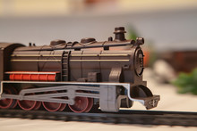 Miniature Toy, Locomotive Train On A Rail