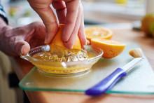 Man Squeezing Orange Juice