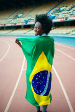 Young Black Athlete In Stadium Carrying Brazilian Flag