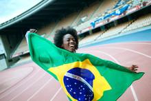 Young Black Athlete In Stadium...