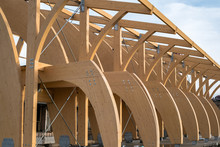 Detail Of A Modern Wooden Architecture In Glued Laminated Timber On A Blue Cloudy Sky