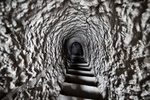 A Staircase Leading To A Dark ...