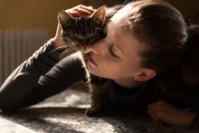 Close Up Of Woman Cuddling Cat