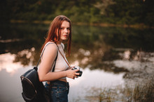 Woman Traveler With Camera Sta...