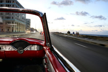 The Malecon In Havana In Cuba From A Classic Convertible Red Car
