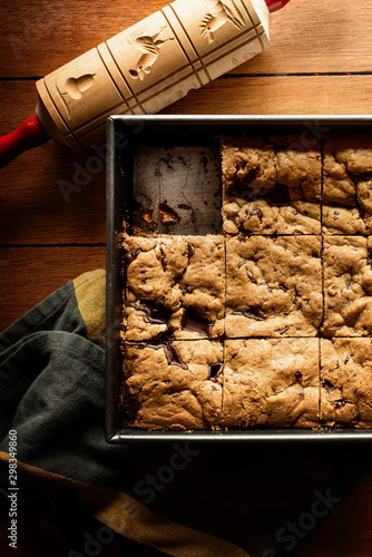 chocolate chip cookie bars sitting in a pan on a kitchen table