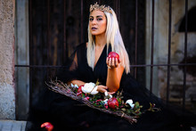 Woman Wearing Evil Princess Ha...