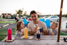 Young Man And Children Eat Ice...