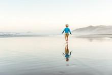 Toddler Boy Running On A Beach...